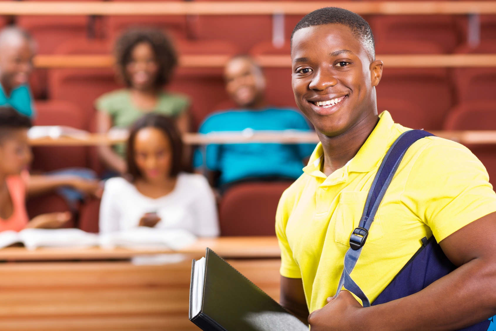 handsome african american college student in lecture hall